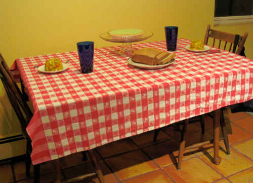 a table sparsely laid out with Spanish Tuna Salad, bread, and Key Lime Pie