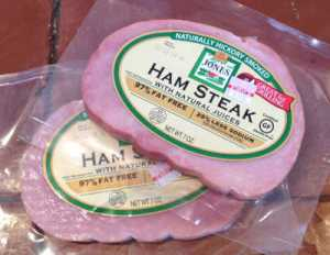two shrink-wrapped 7-oz. ham steaks