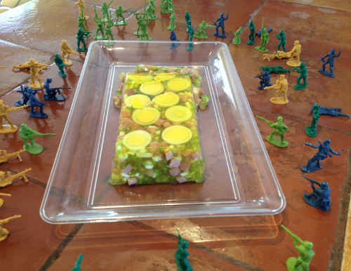 Molded Ham and Egg Salad surrounded by plastic army guys