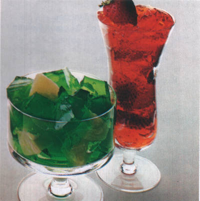 dish of cubed lime Jell-O with chunks of pineapple; tall glass of strawberry Jell-O layered with (one assumes) strawberries