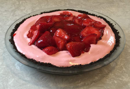 the finished pie - chocolate crumb crust, strawberry bavarian and Jell-O/strawberries in the center