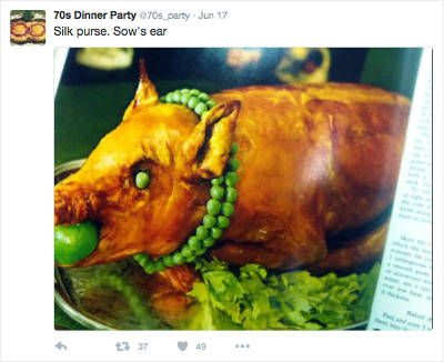 roast pig with green apple in its mouth and double-strand necklace of peas