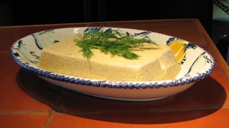 "Yellowish salmon ""mousse"", lovingly garnished with dill, in a fish dish"