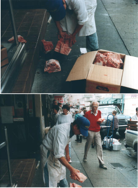 Chinese man breaking apart chunks of frozen meat on a busy sidewalk while a decidedly Anglo older man looks on in disgust