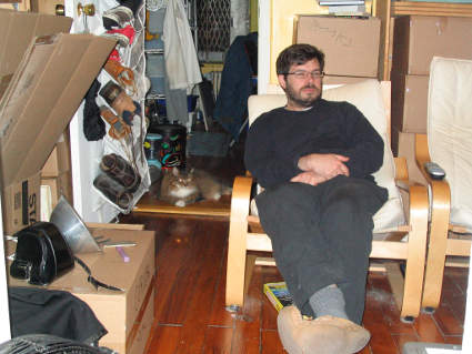 cat and Bryan in cramped apartment