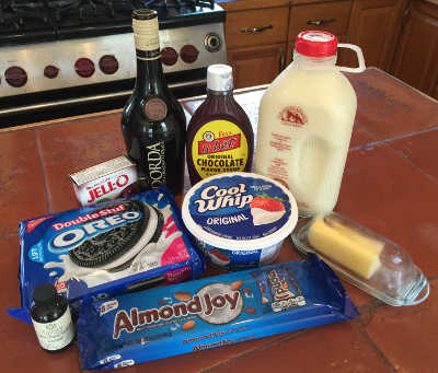 Oreos, Almond Joy, Jell-O instant chocolate pudding, Cool Whip, chocolate liqueur, Fox's U-Bet, milk, butter