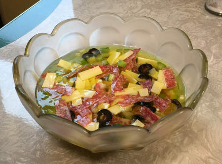 Antipasto Salad - sandwich ingredients floating in a bowl of jelly