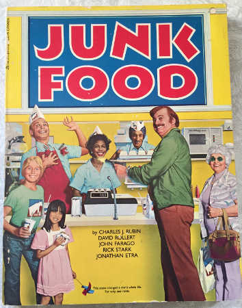 "cover of ""Junk Food"" depicting a satirical fast food restaurant scene"
