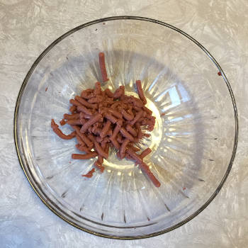 small quantity of Jell-O worms in a glass bowl