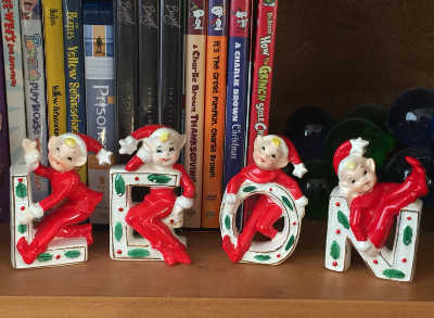 ceramic letters with elves frolicking on them, meant to spell out NOEL