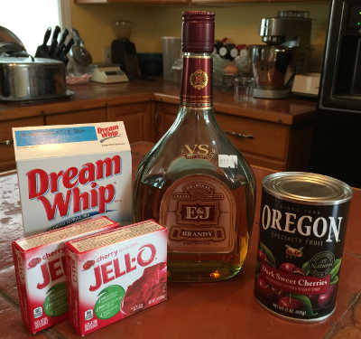 Dream Whip, cherry Jello-O, brandy and canned cherries