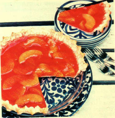 orange Jell-O and peaches set in a pie crust