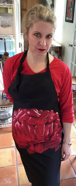 Your Humble Narrator wearing an apron featuring a lurid image of a brain