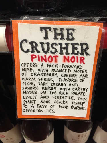 description of wine on shelf sign