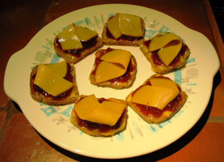 seven mini open-faced, Jell-O coated sandwiches on platter