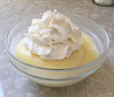 dish of whipped pineapple Jell-O with whipped cream