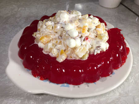 red ring of raspberry Jell-O with mound of weird filling in the center