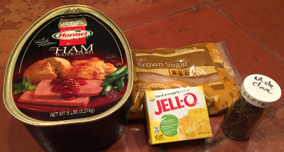 a canned ham, brown sugar, pineapple Jell-O, whole cloves